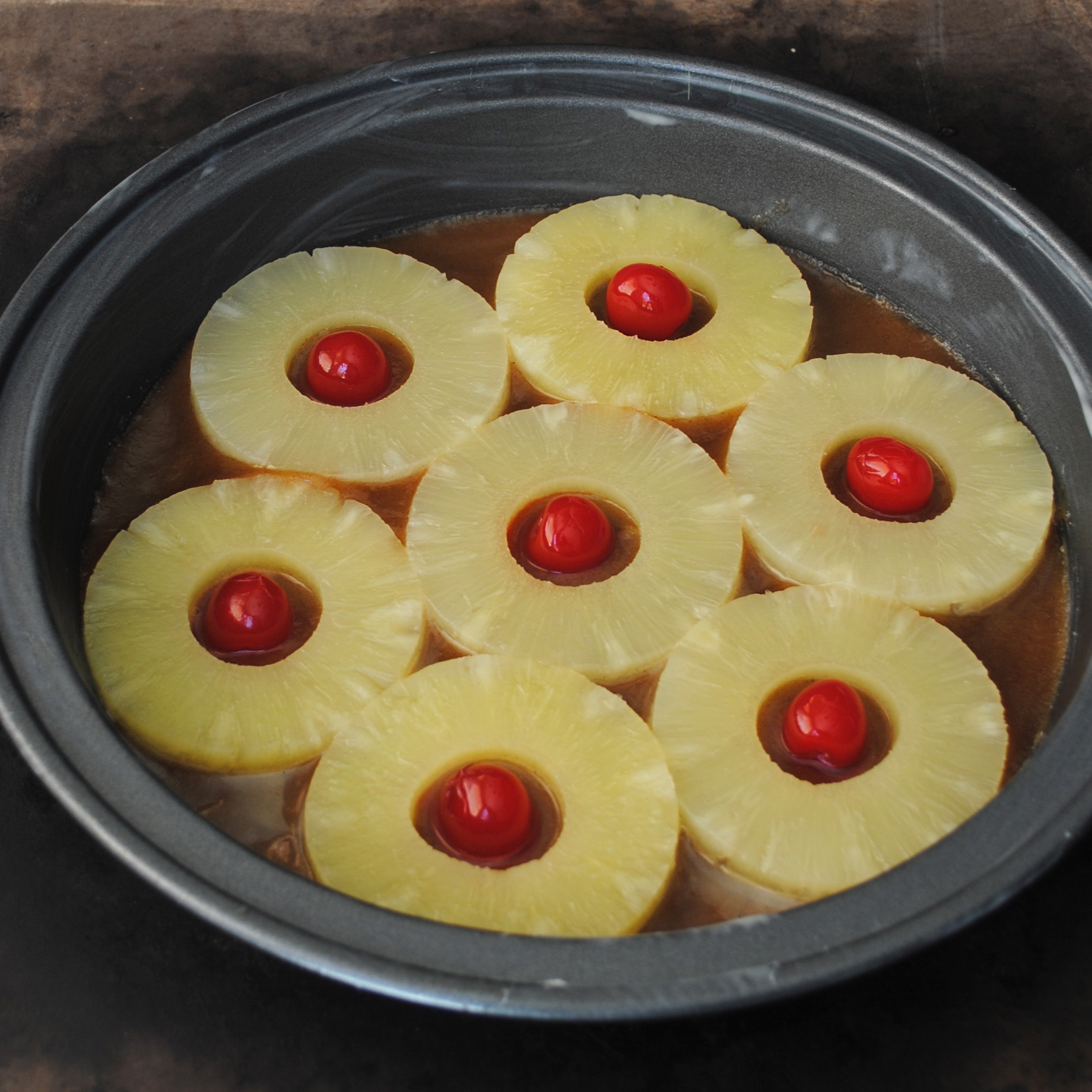 Preparing the pan for Pineapple Upside Down Cake
